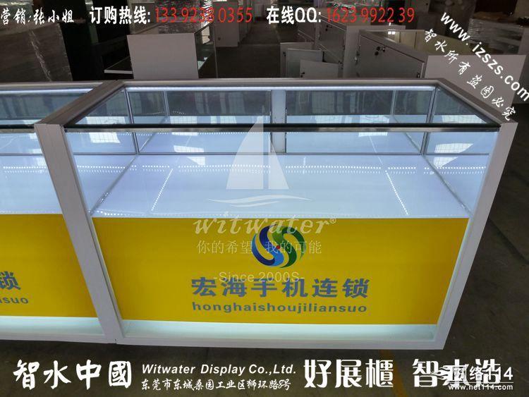 展柜   展台和展柜底座部分采用折 展柜的玻璃可插入台面的沟 槽,四图片